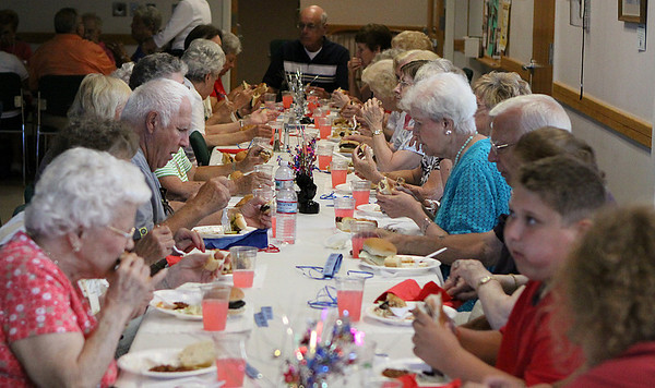 Danvers: Senior Citizens from the Danvers area eat lunch at the Danvers Senior Center on Tuesday afternoon at a luncheon sponsored by the Danvers Council on Aging. Photo by David Le/Salem News