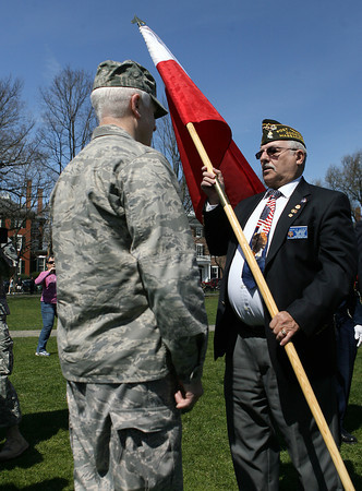 Roger Leger, right, of the Salem Veterans Council, presents Major General L. Scott Rice, of the Massachusetts Air National Guard, a replica 1636 Massachusetts Bay Colony Flag, during the 375th Anniversary Celebration of the National Guard on Salem Common on Saturday morning. David Le/Staff Photo