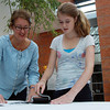 Claire Coen, 13, of Marblehead, and her mom Jan, ink up a design at the Peabody Essex Museum's Street Art Party on Thursday afternoon. David Le/Staff Photo