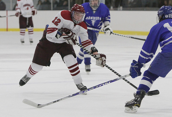 Gloucester's Peter Mondello (12) dangles with the puck against Danvers. David Le/Staff Photo