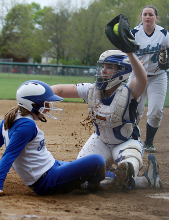Peabody catcher Olivia Brothers, right, holds up the ball for the umpire to see after tagging out Danvers runner Rebecca Hardenstine, left, on Wednesday afternoon. David Le/Staff Photo