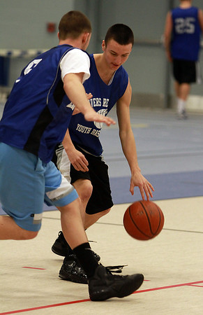 Danvers junior guard Jon Amico, right, tries to get past teammate Nick McKenna, left, during practice on Wednesday. David Le/Staff Photo