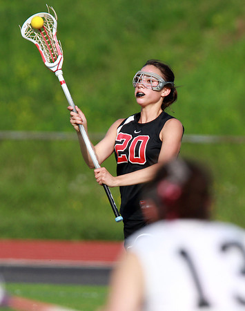 Marblehead defenseman Caroline Helmes passes the ball to a teammate against Beverly on Wednesday afternoon. David Le/Staff Photo