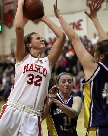 Topsfield: Masco's Brooke Stewart (32) drives through traffic and gets a layin basket. David Le/Salem News