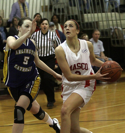Topsfield: Masco's Chelsea Nason (3) right, drives to the hoop for a layup on Thursday night, David Le/Salem News