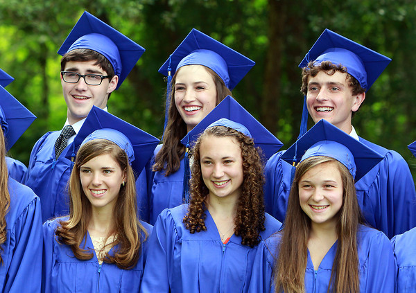 Clockwise from back left: Waring School soon-to-be graduates Evan Supple, Molly Colehower, Casey Ballin, Maggie Sheetz, Caitlin Towers, and Emily Glaenzer, pose for a class photo before their Commencement activities on Friday afternoon. David Le/Staff Photo
