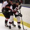 Marblehead's Keelin Fallon (19) carries the puck while being pressured by a Beverly defender. David Le/Salem News