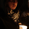The face of Michelle Koen of Peabody, is illuminated only by candlelight at a vigil for Stephanie Moulton, a human service worker who was allegedly murdered by a patient last January. David Le/Salem News