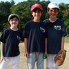 From left, Emily Di Stasio, 8, Jacoby Catanzaro, 8, and Ryan Landry, 9, pose for a photo after the Challenger Little League game. David Le/Staff Photo