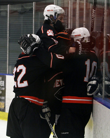 Beverly players mob Brenden Mitchell (10) right, after he scored the Panthers 2nd goal to put them up 2-0 against Danvers. David Le/Salem News