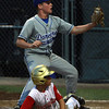 Danvers American starting pitcher Shane Smith, top and Gloucester American baserunner Ben Oliver, bottom, look at the umpire for the call after a close play at home plate. David Le/Staff Photo