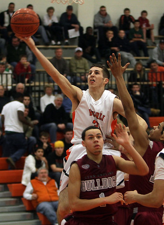 Beverly's Dan Cacciatore (31) lays the ball in over a few Lynn English defenders on Friday night. David Le/Salem News