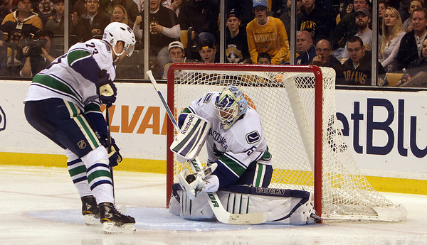 Marblehead native and Vancouver goalie Cory Schneider catches and holds a shot by the Bruins. David Le/Salem News