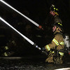 Firefighters work to put out a fire in an apartment complex on Folley Pond Road on Wednesday night. David Le/Salem News