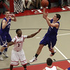 Danvers guard Eric Martin (11) drives into the lane and releases a floater. David Le/Salem News