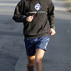Adam Kingsbury, of Marblehead runs along Beach St. in Marblehead on a warm January afternoon. David Le/Salem News.