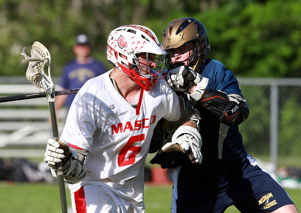 Masco's Kurt Hunziker, left, tries to find room to manuever against Needham defenseman Michael Elcock on Wednesday afternoon. David Le/Staff Photo