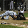 Danvers American's Nic DiScuillo, left, up-ends Andover catcher Kyle Vumbaco on a close play at home plate. David Le/Staff Photo