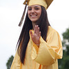Bishop Fenwick senior Anna Witkowski waves to her family while marching in to her Commencement on Friday evening. David Le/Staff Photo