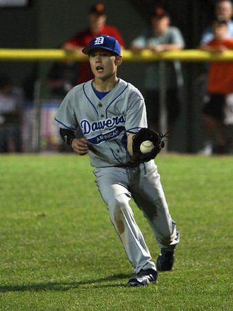 Danvers American right fielder Tim Usalis cleanly fields a base hit and looks to throw out an advancing Saugus American runner on Thursday evening. David Le/Staff Photo
