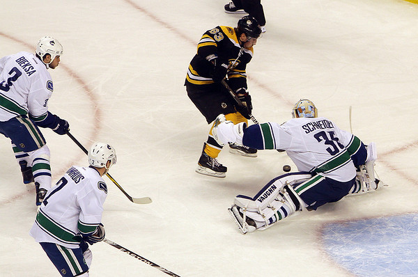 Marblehead native and Vancouver Canucks goalie Cory Schneider sprawls out and saves a shot by Bruins forward Brad Marchand.  David Le/Salem News