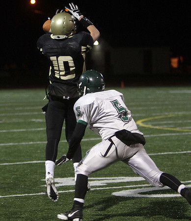 Bishop Fenwick wide receiver Tom Parsons (10) can't manage to hang on to a pass from quarterback Fran Hannon as an Austin Prep defender closes in. David Le/Salem News