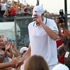 American tennis star John Isner gives high fives to some young fans and tips his cap to the Boston Lobsters fans cheering him as he leaves Joan Norton Stadium at the Ferncroft Country Club for the Olympics in London on Monday evening. David Le/Staff Photo