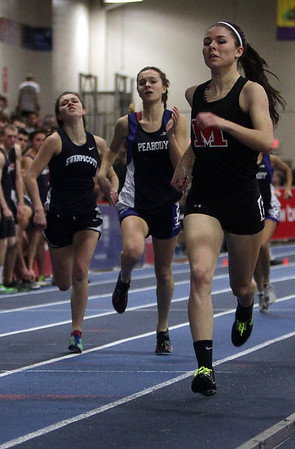 Marblehead's Maura Tubridy, right, holds off Peabody's Sarah May, center, and Swampscott's Emma Walsh in the 600 meter run on Thursday afternoon at the Reggie Lewis Center in Roxbury. David Le/Salem News