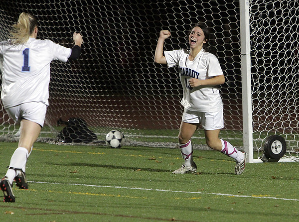 Peabody High School junior striker Victoria Digiacomo (13) right, pumps her fist in celebration after she knocked home the game winning goal for the Tanners, propelling them to a 2-1 win over Oliver Ames. David Le/Salem News