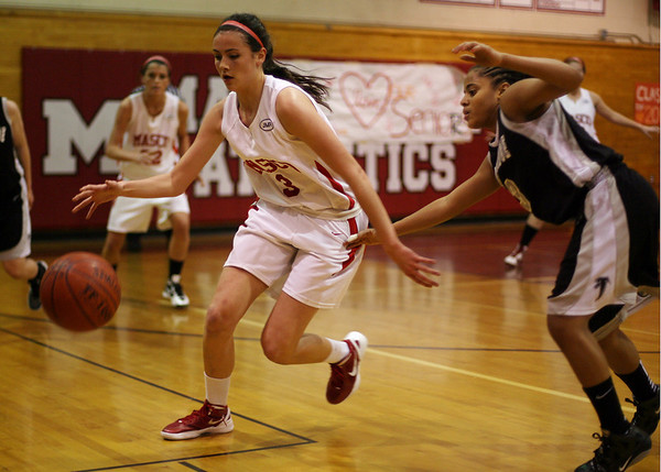 Masco senior Chelsea Nason brings the ball upcourt while being pressured by a Cambridge defender. David Le/Salem News