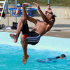 Yan Carlos Rodriguez, 17, of Salem, does a backflip into the swimming pool at Forest River Park on a hot July afternoon.David Le/Staff Photo