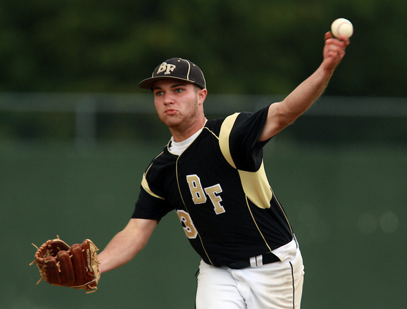 Bishop Fenwick starting pitcher Kevin Church fires a strike against Lynnfield on Thursday afternoon. David Le/Staff Photo