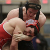 Beverly wrestler TJ McGovern, top, locks up with Tewksbury's Joe Burger, bottom, on Saturday at the state wrestling semifinals at Beverly High School. David Le/Salem News