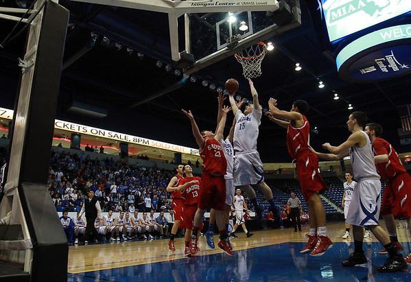 Danvers junior Nick Bates (15), center, battles for a rebound with Saugus junior Shane Ripley (23) during the D3 North Final at the Tsongas Center in Lowell on Saturday afternoon., David Le/Staff Photo