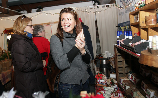 Charlotte Mullaney, of Salem, tries out some hand lotion at the Salem Soapworks stand at the Winter Farmers Market along Artists' Row in Salem on Thursday afternoon. David Le/Salem News