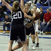 Peabody's Olivia Summit, right, peers around Swampscott's Caroline Murphy (20) left, and up at the hoop. David Le/Salem News