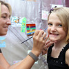 Maeve Zahornacky, 9, of Amesbury, gets her face painted by Tracy Chase, of Danvers, at the Salem Jazz and Soul Festival on Saturday morning. David Le/Staff Photo