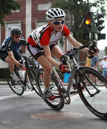Beverly: Two competitors in the Women's Race of the Beverly Grand Prix sharply lean into a corner as they pass the Beverly Public Library and glide onto Dane St. The Grand Prix started at 4:30 Wednesday afternoon and lasted well into the evening. Photo by David Le/Salem News