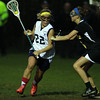 Peabody's Bianca Muscato, left, drives past Bishop Fenwick's Grace Celona, right, on Friday evening. David Le/Staff Photo