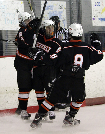 Beverly sophomore Connor Irving (22) center, and freshman Nick Albano (8) right, congratulate senior captain Andrew Irving (7) left, on his 2nd of 4 goals on Monday afternoon. David Le/Staff Photo