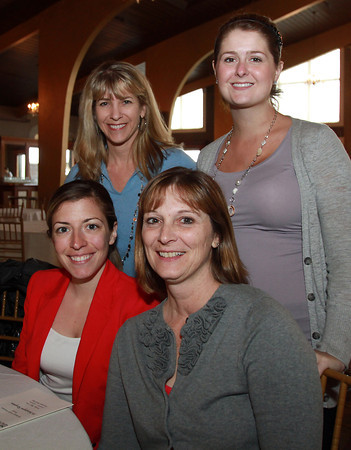 Beverly teachers clockwise from left, Janelle Bruno, Danielle Hopkins, Krista Ackerman, and Jill Aylward, at a Celebration of Excellence, honoring retiring and new teachers, at the Danversport Yacht Club. David Le/Staff Photo