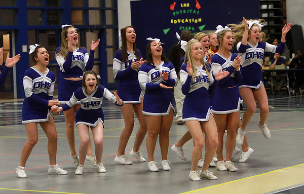 The Danvers High School Cheerleaders celebrate after two free throws by George Merry gave the Falcons a three point lead and victory over Wayland on Tuesday night. David Le/Staff Photo
