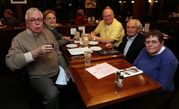 Clockwise from left, Paul Redmond, Linda and Don Doliber, and John and Leslie Stucke at Museum Night hosted by The Landing Restaurant in Marblehead. David Le/Salem News