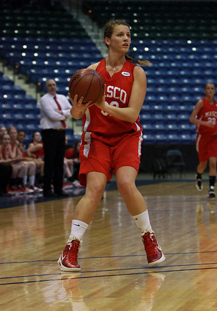 Masco senior Brooke Stewart lines up a 3-point shot against Andover. David Le/Staff Photo