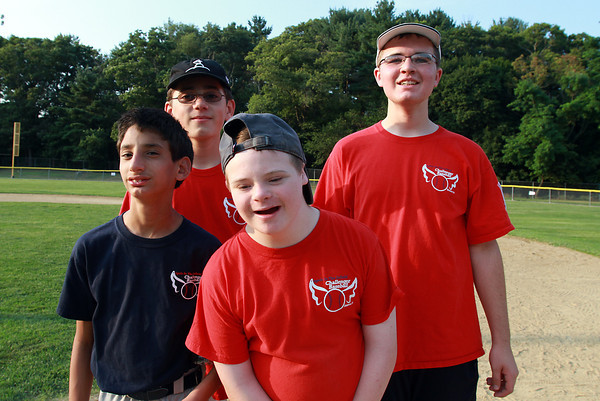 From left, Tio Abbatessa, 12, Tyler Bramante, 13, Steve Roller, 13, and Brendan Biancucci, 15, participated in the Challenger Little League game. David Le/Staff Photo