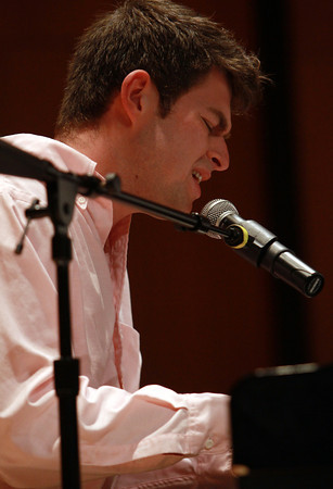 "Endicott College student Will Maier, of Salem, plays a piano solo and sings ""My Funny Valentine"" during Endicott's Inter-School Jazz Festival held in the Rose Performance Hall on Thursday evening. David Le/Staff Photo"