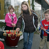 From left, Paige,7, Hannah, 9, and Seamus Crowley, 5, get candy canes from Santa Claus along Atlantic Ave on Sunday. David Le/Salem News