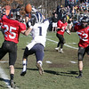 Swampscott receiver AJ Baker (1) cannot hang onto a football throw by quarterback Mike Walsh as Marblehead's Zac Cuzner (25) and Oliver Gregory (52) close in. David Le/Salem News