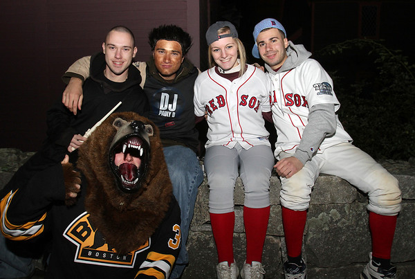 Clockwise from front left, Mike Archimbald, Anthony Poto, Joey Guarneram Casey Harrison, and Matt Weagle, of Chelmsford, hang out near the Witches Memorial on Halloween night. David Le/Staff Photo.