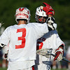 Masco's Wes Shrewsbury, left, gets congratulated by teammate Tim Towler, right, after Shrewsbury scored one of his 3 goals against Beverly.David Le/Staff Photo